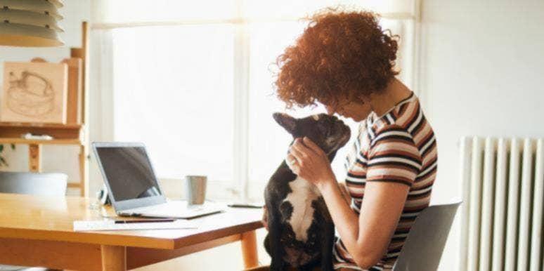 woman cuddling with a dog