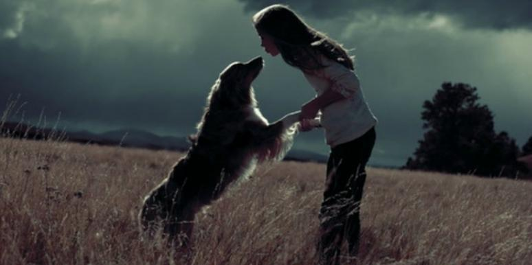 Girl kissing her dog