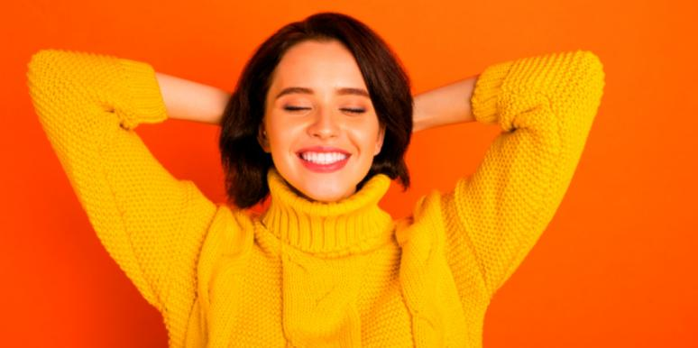 woman in yellow shirt relaxing red background