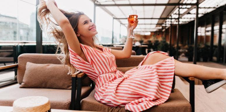 woman in dress drinking