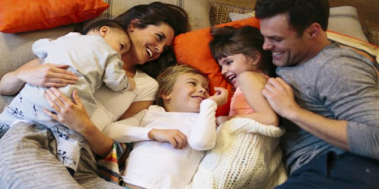 family laying together laughing