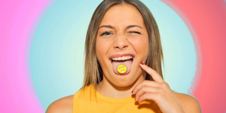 woman with smiley face on her tongue