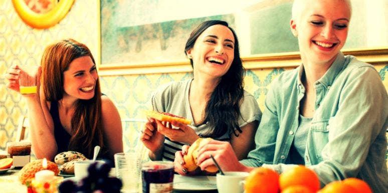 three happy women eating