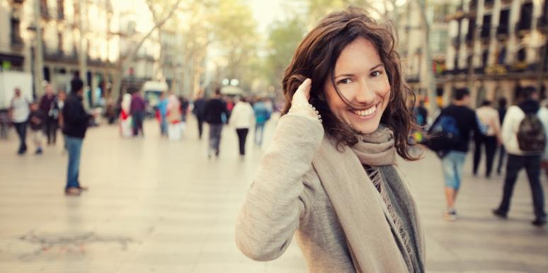 happy and energetic woman in winter cityscape