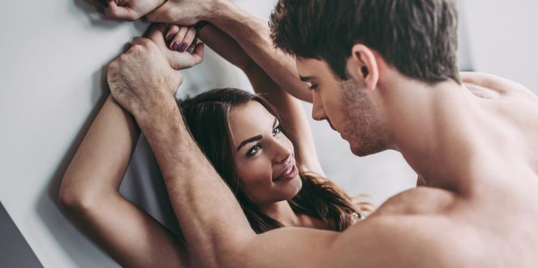 man and woman making eye contact during sex