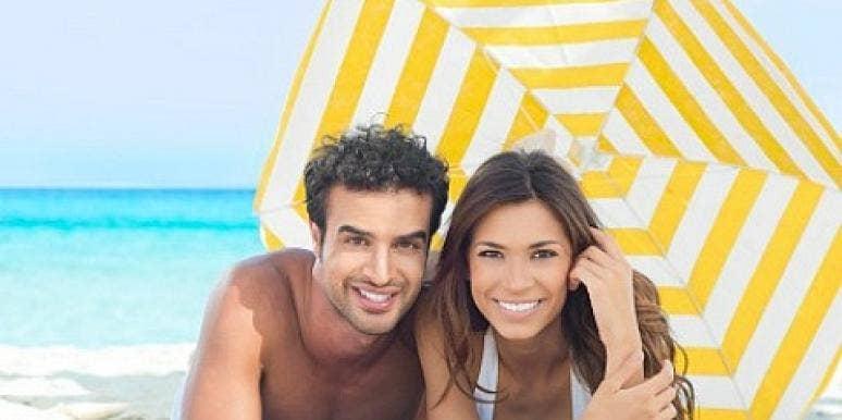 couple under umbrella on beach