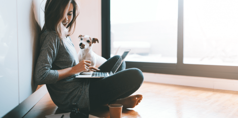 woman on laptop with dog