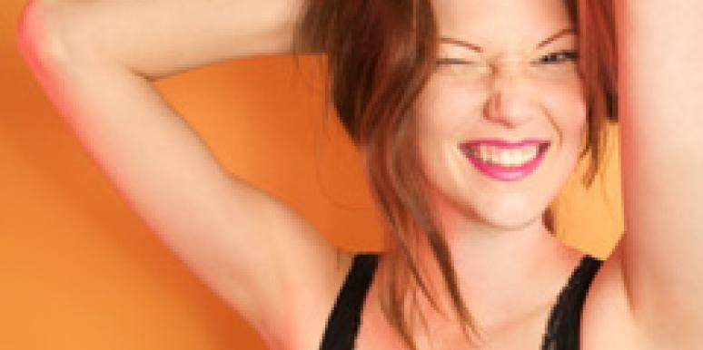 woman flirting holding hair winking