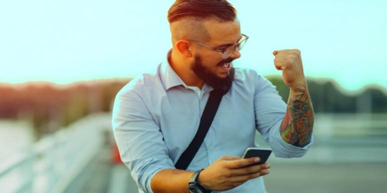 excited man on his phone sending flirty texts
