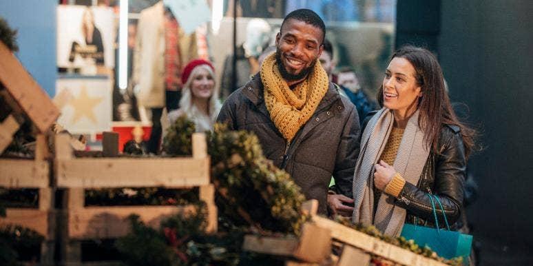 man and woman christmas tree shopping