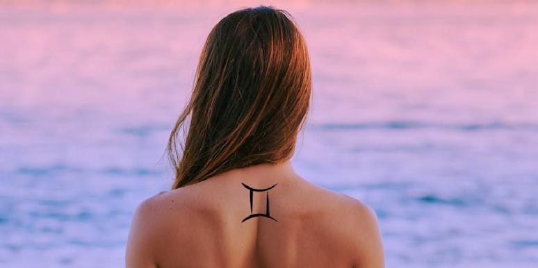 woman with gemini tattoo on back