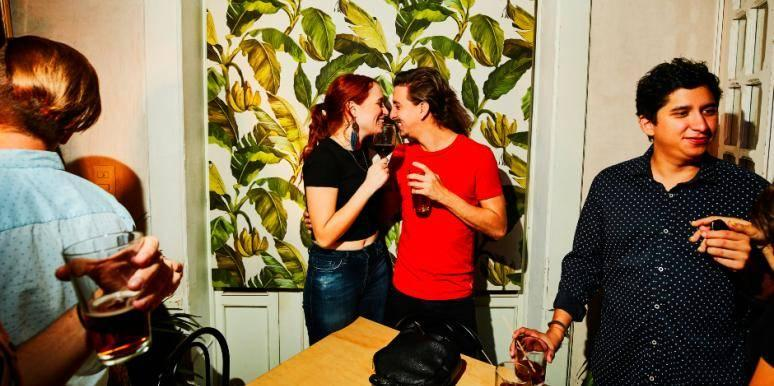 flirty couple at a party kissing