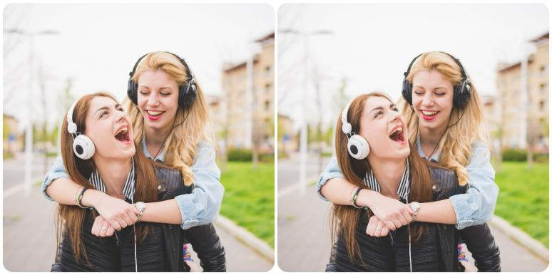 woman with headphones giving piggyback ride to another woman