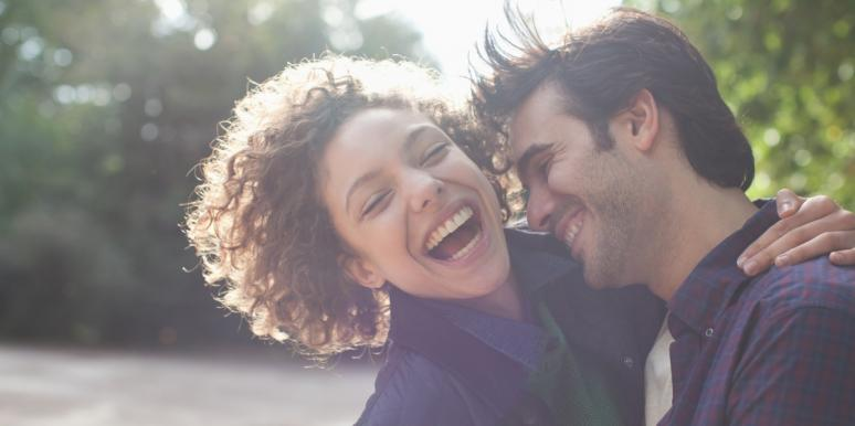 happy man and woman hugging