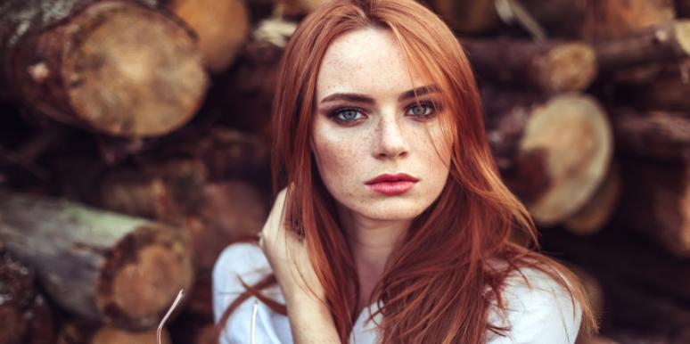red head woman sad somber looking forward