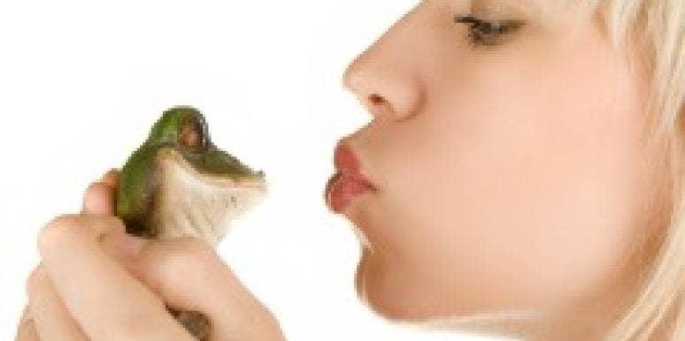 girl kissing frog