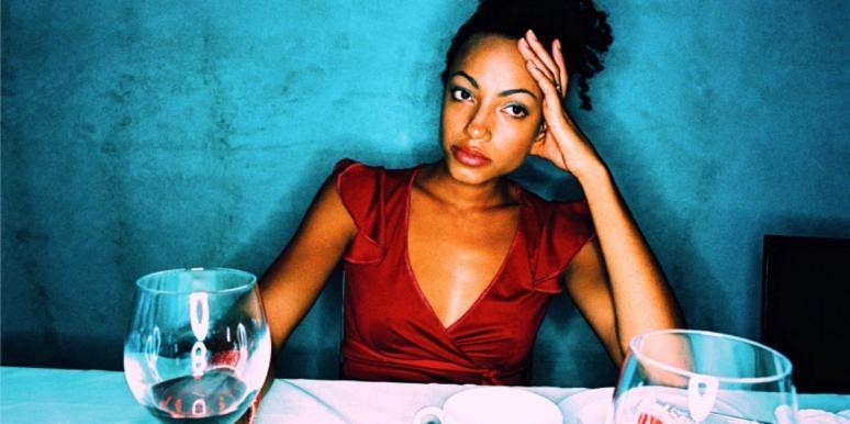 negative woman at table