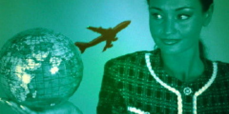 Woman holding globe and plane