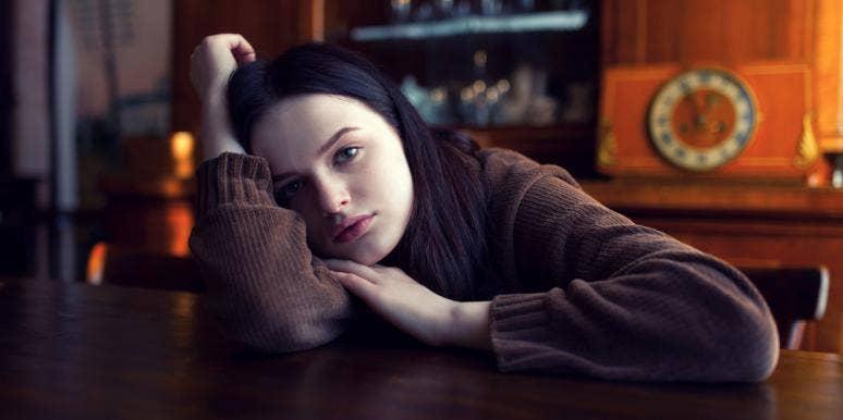 unhappy woman in dark room