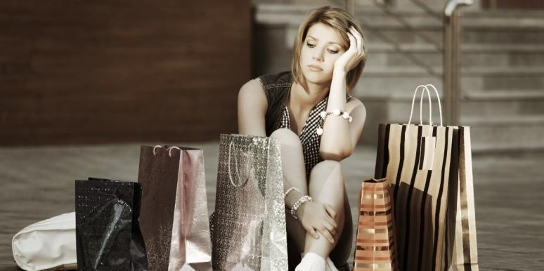 woman sitting on the floor with shopping bags