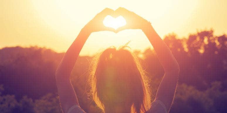 hands heart in sky