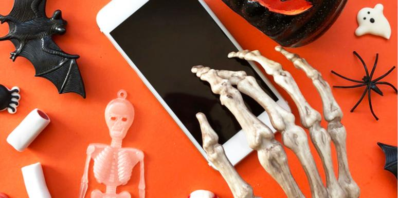 skeleton hand on phone