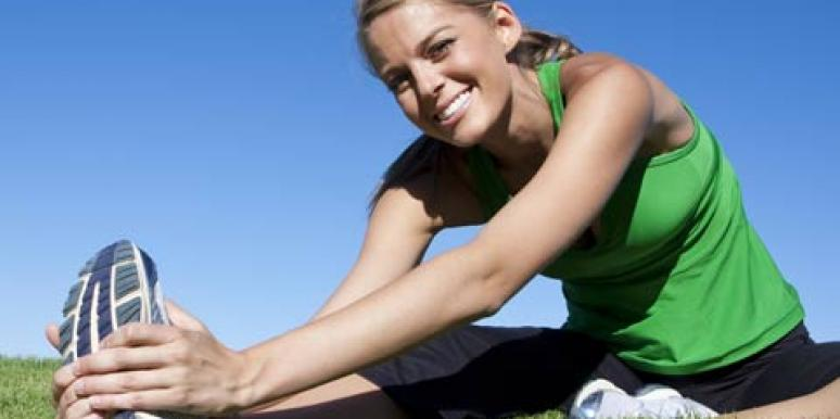 happy woman stretching before a run