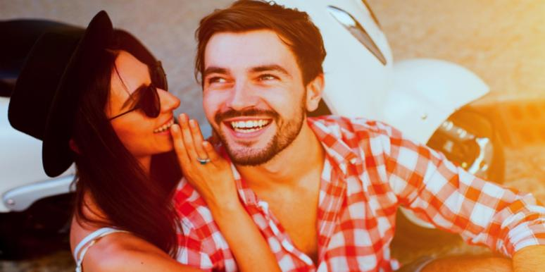 man and woman laughing together