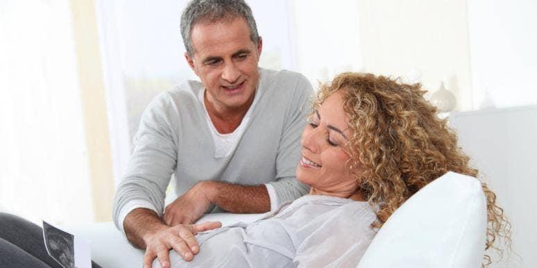 pregnant woman and husband looking at sonogram