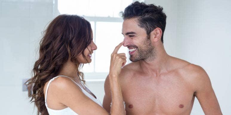 funny couple goofing around smiling