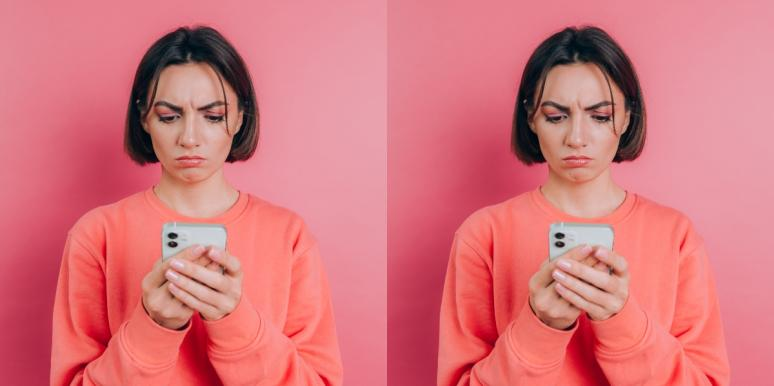 woman in monochrome pink looking at phone