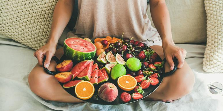 woman with fruit platter