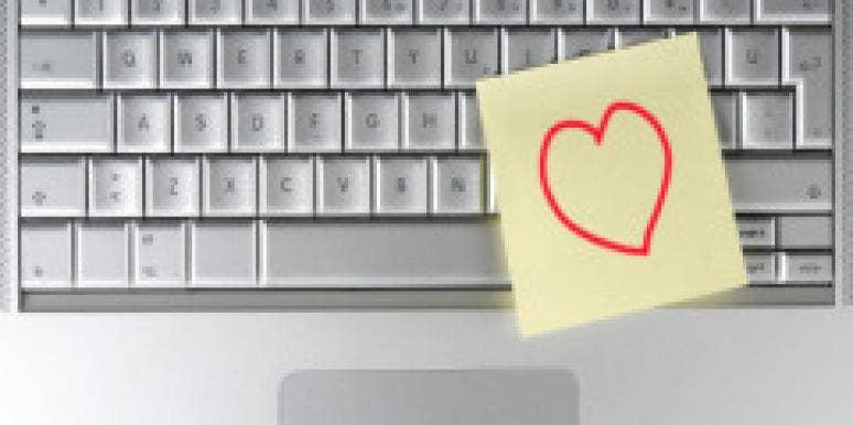 heart post it note on silver keyboard