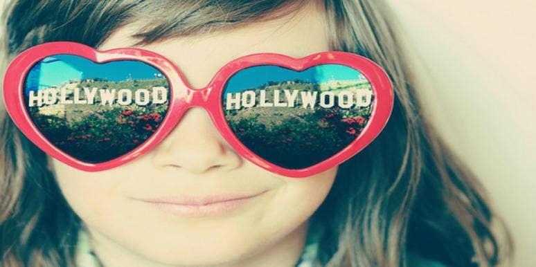 little girl admires hollywood stars