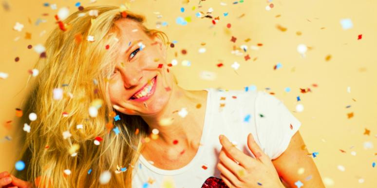 happy woman surrounded by confetti