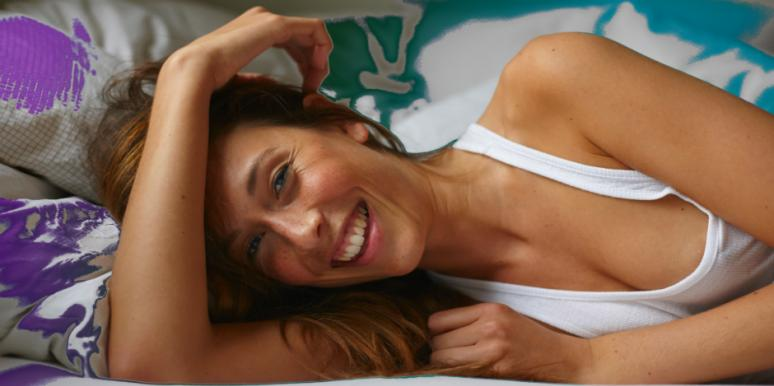 smiling woman lying on her side