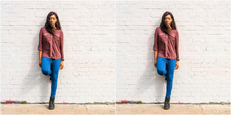 mirrored image of woman leaning against brick wall