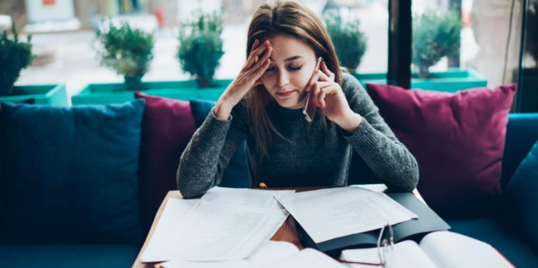 woman stressed with work papers