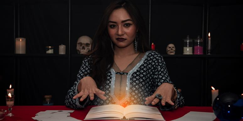 woman at table performing psychic reading