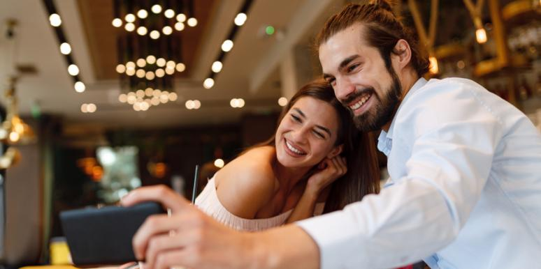 dating couple taking selfie