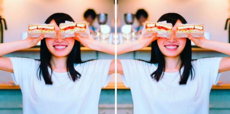 woman smiling with sandwiches for eyes