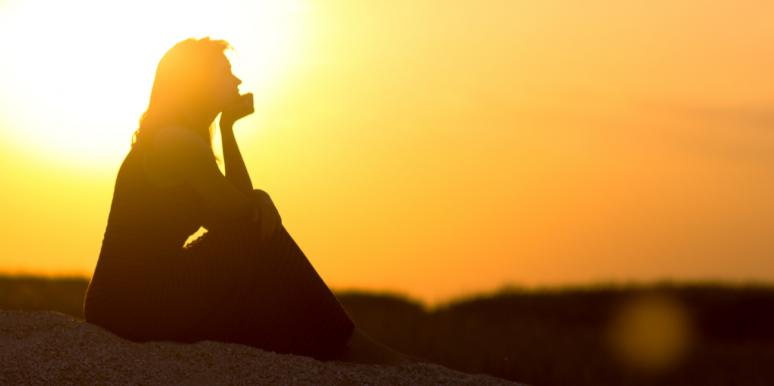 woman sitting in sunset
