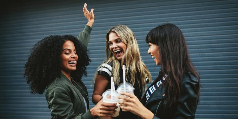 three female friends cheersing coffee
