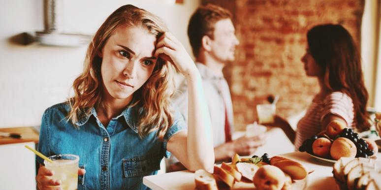 upset woman in the kitchen with friends