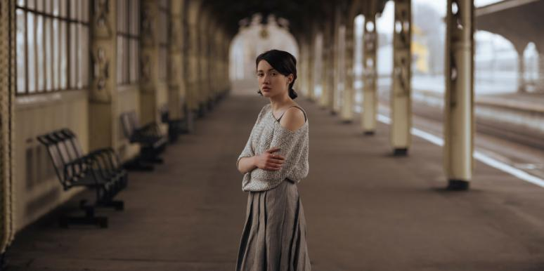 heartbroken woman in train station