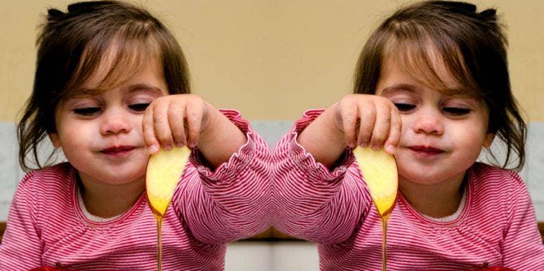 girl eating apples and honey on Rosh Hashanah