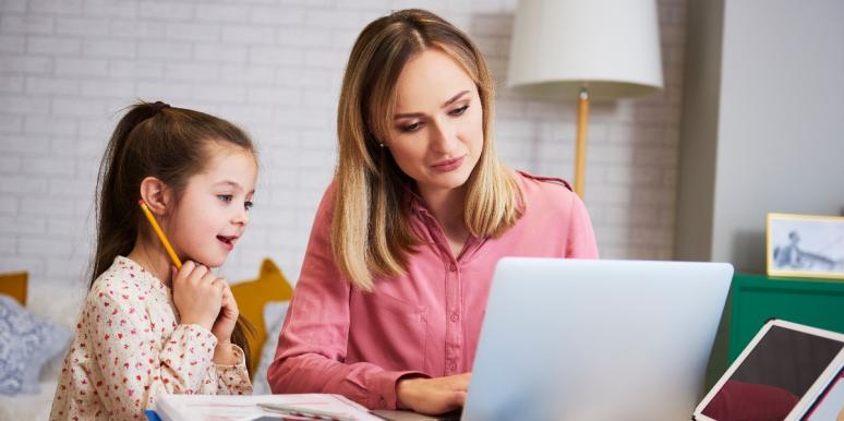 mother and daughter homeschooling