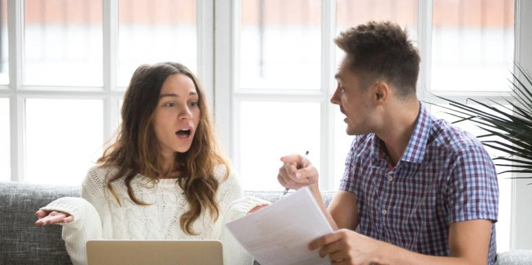 Shocked woman with husband wondering about financial abuse