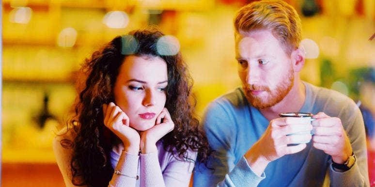 sad-looking couple having coffee