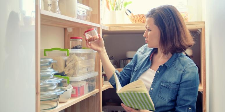 woman with a book looking at ingredients